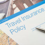 Insurer ordered to pay for emergency surgery while travelling.